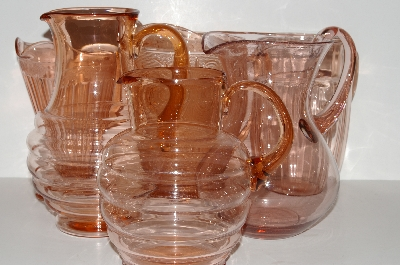 Beautiful Pink Depression Glass Pitchers
