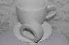 "+MBAMG #003-235   ""Set Of 8/ 4 Coffee Cups & 4 Napkin Rings/ White Ceramic/Poinsettia Pattern"""