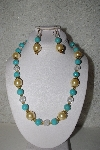 "MBAHB #00014-8697  ""One Of A Kind Gold, Clear & Blue Bead Necklace & Earring Set"""