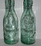"MBA #2727-559   ""Set Of 2 1980's Sea Green Glass Cow Milk Bottles"""