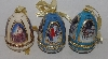 "MBA #3535-623   ""Set Of 3 Handcrafted Porcelain Christmas Themed Egg Ornaments"""