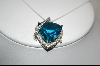 Fancy Trillion Cut Blue Topaz & Diamond Pendant