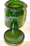 "MBA #15-026    ""Biller & Jones Dark Bottle Green Glass Topped Canister"