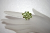 9 Stone Oval Cut Peridot 14K Ring