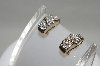 MBA #78-025     14K Yellow Gold Cross Over Diamond Earrings