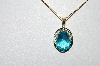 "14k Yellow Gold Oval Cut Blue Topaz Pendant With 18"" Chain"