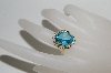 14K Yellow Gold Oval Cut Blue Topaz Ring