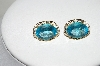 MBA #80-0074     14k Yellow Gold Oval Cut Blue Topaz Earrings