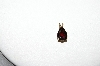 MBA #85-215     14K Yellow Gold Pear Cut Garnet Pendant