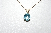 "MBA #87-221  ""14K Yellow Gold Set Oval Blue Topaz Pendant With 16"" Chain"""